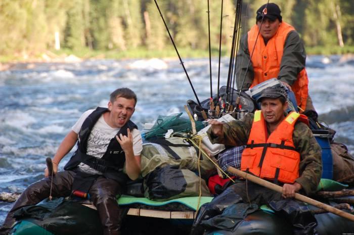 Три рыбака в лодке
