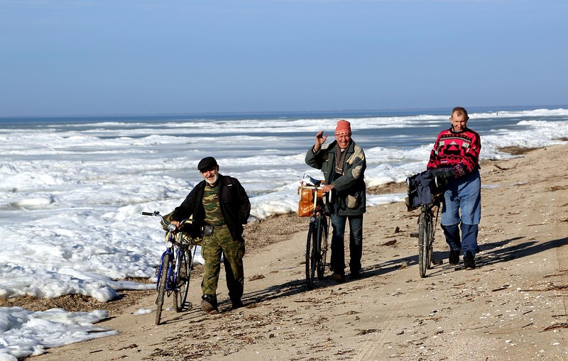 Три рыбака на велосипедах