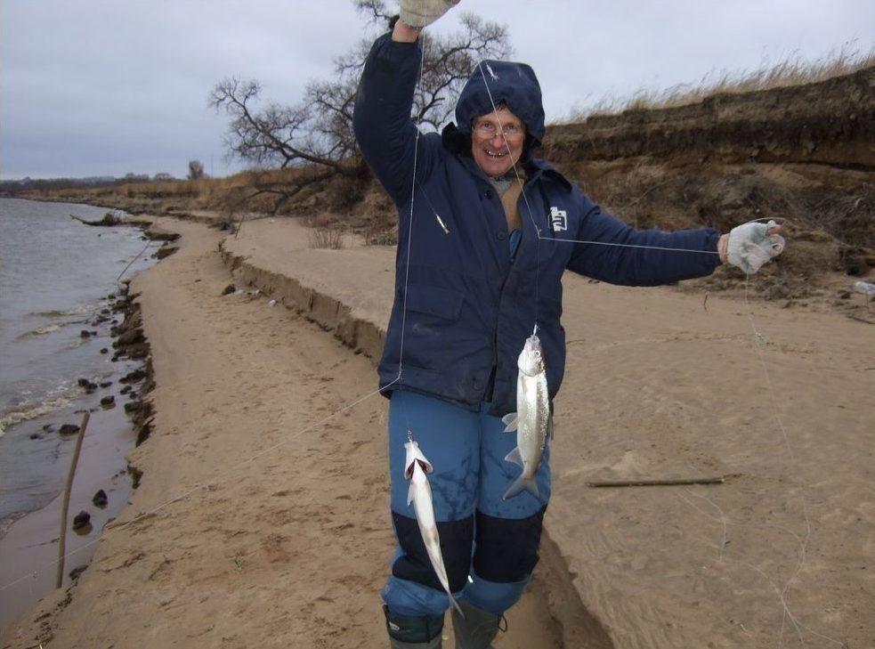 Довольный рыбак